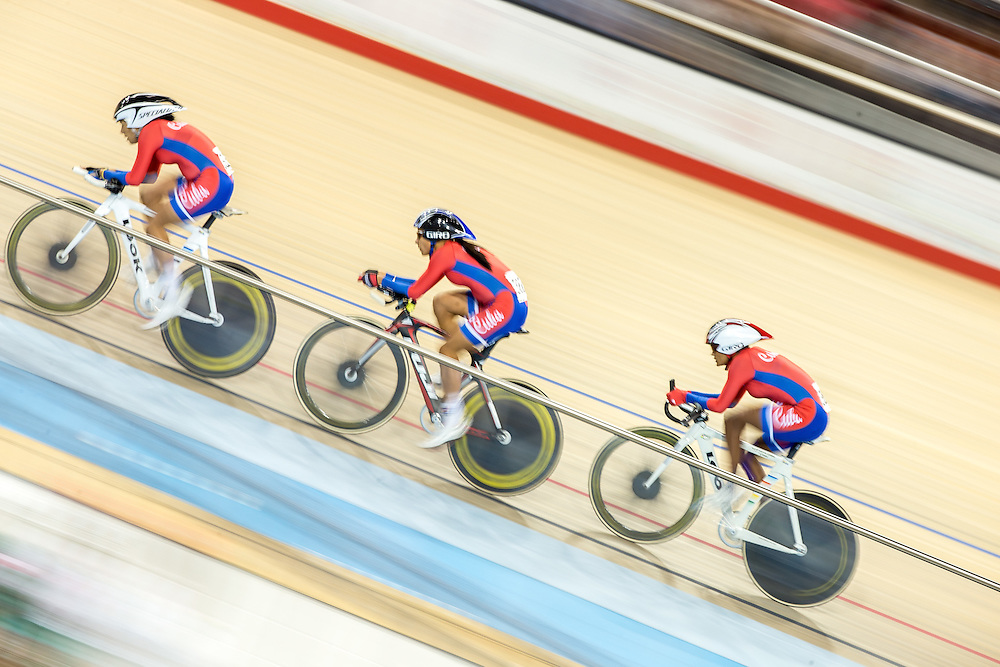 Cuba's team of (L-R) Yeima Torres, Arlenis Sierra and<br /> Yumari Gonzalez race in the women's cycling team pursuit at the 2015 Pan American Games in Toronto, Canada, July 17,  2015.  AFP PHOTO/GEOFF ROBINS