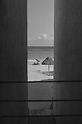 View between buildings of beach and umbrella in Playa del Carmen on the Yucatan Peninsula in Mexico (1984)