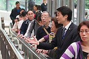 "The Central - Mid-Levels Escalator eases ""vertical commuting"" for tens of thousands of Hong Kong citizens daily."