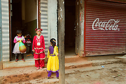 "Kumari Dangol waits for the start of a festival outside her home. As society evolves, so must the tradition said former kumari Chanira Vajracharya, now 19. ""There are things that should be improved for the welfare of the kumaris, like greater financial support from the government to cover the expenses of rituals and the goddess's education. And counseling to explain how her life will change after she finishes as kumari,"" she said. ""I'm worried that if we don't see these changes, we may lose the tradition altogether."""