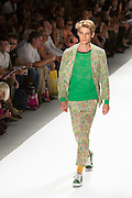 Men's print pants and matching jacket with a green print T. By Custo Barcelona at the Spring 2013 Fashion Week show in New York.