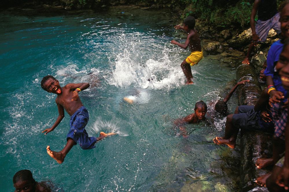 Local kids play in freshwater pool near Kindu Village, New Georgia Island, The Solomon islands