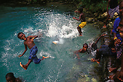 Local kids play in freshwater pool near Kindu Village, New Georgia Island, The Solomon islands