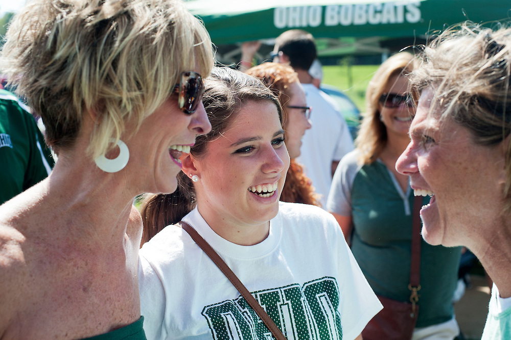 Michelle Stewart (left), Sarah Goldsberry (center) and Maggie Goldsberry (right) talk during the pre-game tailgate party which was held on saturday in the field across from Peden Stadium. Photo by: Ross Brinkerhoff.