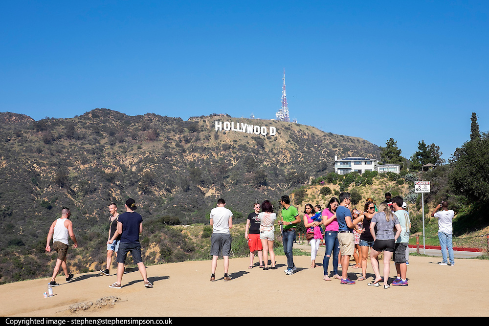 © Licensed to London News Pictures. 15/02/2015. Los Angeles, USA Tourists photograph the Hollywood sign in Los Angeles, California. Photo credit : Stephen Simpson/LNP