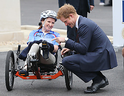 Prince Harry talks to wounded service woman Cpl Claire Edwards before before she takes part in the 2013 Hero Ride during the Prince's visit to the Help For Heroes Recovery Centre in Tidworth, Wiltshire, Monday, 20th May 2013 Picture by: Stephen Lock / i-Images