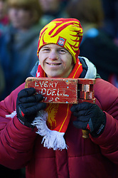 LIVERPOOL, ENGLAND - Sunday, December 13, 2009: A Liverpool supporter with an old rattle during the Premiership match against Arsenal at Anfield. (Photo by: David Rawcliffe/Propaganda)