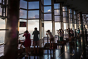 Tourists view the skyline from the Jin Mao Tower Skywalk indoor observation deck Shanghai, China.