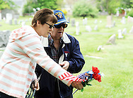 Robin White (left), of Hatboro, Pennsylvania and Robert White of Horsham, Pennsylvania visit the grave of Sgt. George Warren Fryling, who was killed in action in France during World War I at age 29, and is a relative Sunday May 22, 2016 at St. Luke's Cemetery in Dublin, Pennsylvania. (Photo by William Thomas Cain)
