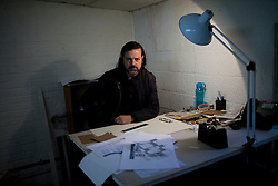 Mauricio Rocha sits for a portrait in the the workshop were models are made at his office in Mexico City.