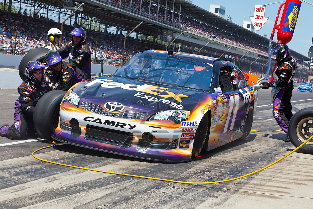 INDIANPOLIS, IN - JUL 29, 2012:  Denny Hamlin (11) brings his Sprint Cup Series race car in for service during the Sprint Cup Series race at the Indianapolis Motor Speedway in Indianapolis, IN.