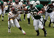 Norfolk State running back Daryl Jones (32) makes this run against Bethune-Cookman at Dick Price Stadium in Norfolk, Virginia.  Bethune won 63-61 in 4OT.  September 24, 2005  (Photo by Mark W. Sutton)