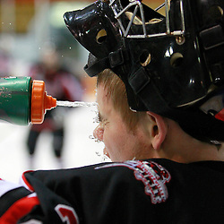 NEWMARKET, ON - Feb 4 : Ontario Junior Hockey League Game Action between the Stouffville Spirit and the Newmarket Hurricanes, Tim Bester #33 of the Stouffville Spirit Hockey Club takes a drink during the pre-game warm-up.<br /> (Photo by Brian Watts / OJHL Images)