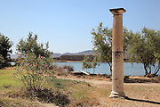 Fluted column with capital at the entrance to the ancient city of Butrint, Chaonia, Albania. Butrint was founded by the Greek Chaonian tribe and was a port throughout Hellenistic and Roman times, when it was known as Buthrotum. It was ruled by the Byzantines and the Venetians and finally abandoned in the Middle Ages. The ruins at Butrint were listed as a UNESCO World Heritage Site in 1992. Picture by Manuel Cohen