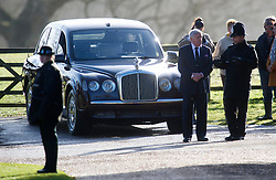 HM The Queen chauffeur talks to police officers as the Queen and the Duke Of Edinburgh attend Church at Sandringham, Sunday January 27, 2013. Photo: Andrew Parsons / i-Images