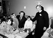 Minister for Health and Social Welfare, Charles Haughey, with young patients at Letterkenny County Hospital/Health Centre.<br />