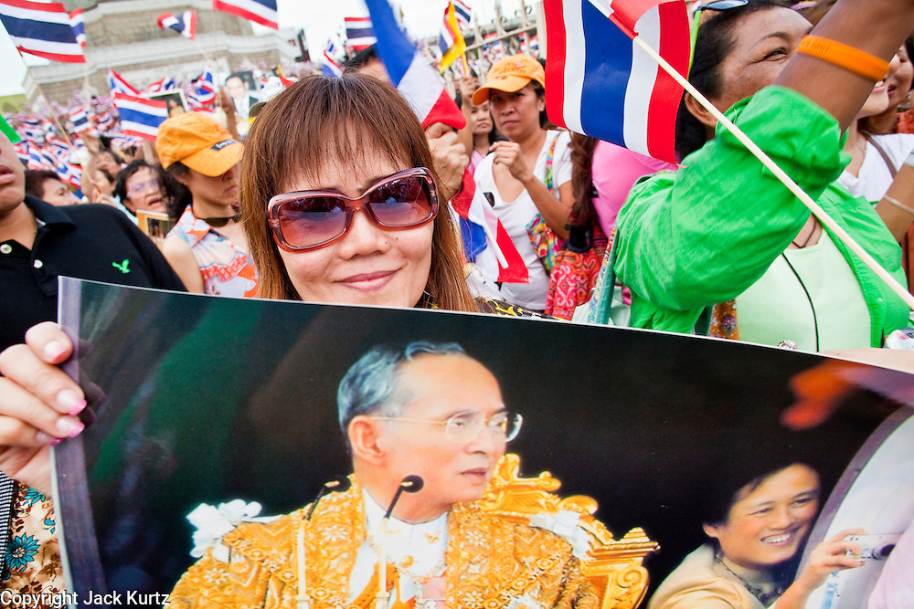 """Apr. 18, 2010 - Bangkok, Thailand: A Pink Shirt holds up a photo of Thai King Bhumibol Adulyadej during a peace rally Sunday. Thousands of so called """"Pink Shirts"""" jammed the area around Victory Monument in Bangkok to show support the Thai Monarch, King Bhumibol Adulyadej, and against the Red Shirts, who are demonstrating just a few kilometres away in the Ratchaprasong area. The Pink Shirts claim to not support either of the other political factions who wear colors - the Red Shirts, who support deposed Prime Minister Thaksin Shinawatra and their opponents the Yellow Shirts, who are against Thaksin.    Photo By Jack Kurtz"""