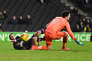Portsmouth striker Conor Chaplin (19) forces the ball past Milton Keynes Dons goalkeeper Lee Nicholls (1) to score the winning goal 1-2 during the EFL Sky Bet League 1 match between Milton Keynes Dons and Portsmouth at stadium:mk, Milton Keynes, England on 10 February 2018. Picture by Dennis Goodwin.