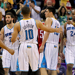 April 19, 2012; New Orleans, LA, USA; \New Orleans Hornets power forward Carl Landry (24) celebrates with shooting guard Eric Gordon (10) during overtime  against the Houston Rockets at the New Orleans Arena. The Hornets defeated the Rockets 105-99.   Mandatory Credit: Derick E. Hingle-US PRESSWIRE