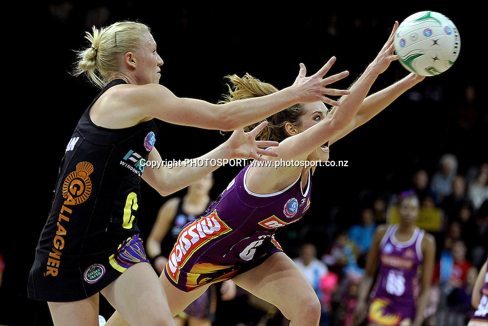Firebirds' Elissa Macleod goes for the intercept against Magic's Laura Langman. ANZ Netball Championship, Waikato/Bay of Plenty Magic v Queensland Firebirds, Claudelands Arena, Hamilton, New Zealand. Monday 2nd July 2012. Photo: Anthony Au-Yeung / photosport.co.nz