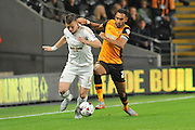 Ahmed Elmohamady and Franck Tabanou fight for the ball during the Capital One Cup match between Hull City and Swansea City at the KC Stadium, Kingston upon Hull, England on 22 September 2015. Photo by Ian Lyall.