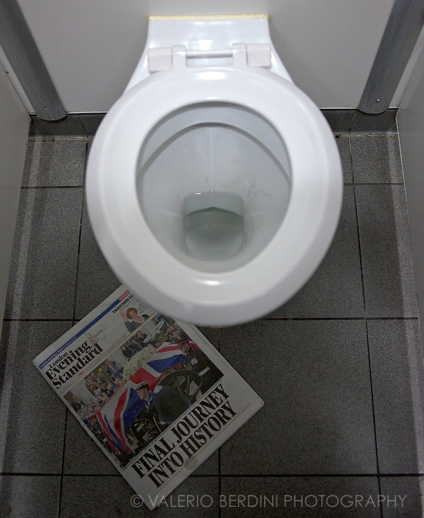 Someone left a copy in a toilet at Victoria Station in London. The juxtaposition sprang to my mind and created this photo story.