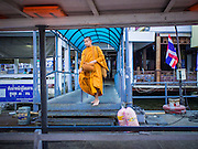 15 FEBRUARY 2015 - BANGKOK, THAILAND:  Buddhist monks board a cross river ferry at the flower market in Bangkok to go across the Chao Phraya River to the Kudeejeen neighborhood.      PHOTO BY JACK KURTZ