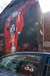 LIVERPOOL, ENGLAND - Monday, August 3, 2020: A street art mural of Liverpool's captain Jordan Henderson lifting the Premier League trophy, with the reflection of a mural of Trent Alexander-Arnold in a car window. (Pic by David Rawcliffe/Propaganda)