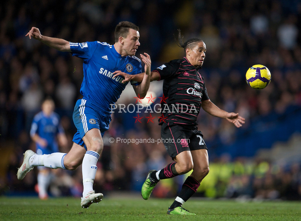 LONDON, ENGLAND - Saturday, December 12, 2009: Everton's Steven Pienaar and Chelsea's captain John Terry during the Premiership match at Stamford Bridge. (Photo by David Rawcliffe/Propaganda)