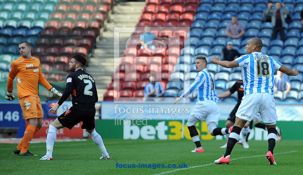 Picture by Graham Crowther/Focus Images Ltd +44 7763 140036.15/09/2012.Danny Ward of Huddersfield Town watches his header go past to score the opening goal againstf Derby County during the npower Championship match at the John Smiths Stadium, Huddersfield.