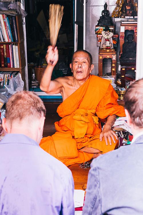 Monk blessing David Thompson and Tom Parker-Bowles at the Royal Place, Bangkok