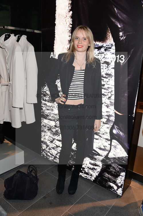 SCARLETT CARLOS CLARKE at the opening of the Tiger of Sweden Store, 210 Piccadilly, London on 3rd October 2013.