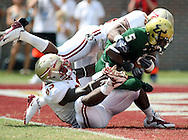 FSU's Defensive Tackle #93 Everett Dawkins and Linebacker #36, Dekoda Watson pulls USF's RB Lindsey Lamar into the end zone for what appeared to be a Safety only to be ruled down on the 1 yard line.  USF defeated No. 18 FSU 17-7, Saturday, 26 Sep 09, at Doak Campbell Stadium in front of 12,000 fans. First meeting between the schools and was viewed by FSU's biggest home crowd in four years.