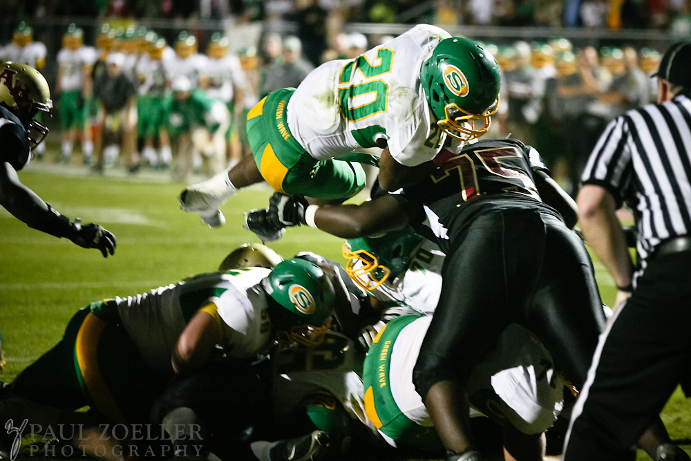 Summerville's Jerod Tucker dives over Ashley Ridge defenders for a touch down Friday, Oct. 26, 2012 at Ashley Ridge High School in Summerville. Paul Zoeller/Special to the Post and Courier