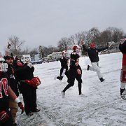 New Canaan players and coaches celebrate a touchdown during the New Canaan Rams Vs Darien Blue Wave, CIAC Football Championship Class L Final at Boyle Stadium, Stamford. The New Canaan Rams won the match in snowy conditions 44-12. Stamford,  Connecticut, USA. 14th December 2013. Photo Tim Clayton