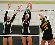 Springville's Megan Wagaman (14) and Leanna Mysak (9) block a shot by New London's Morgan Christner (16) in the Class 1A regional final match at Iowa City West High School in Iowa City on Wednesday, November 6, 2013. Springville defeated New London 3-2.