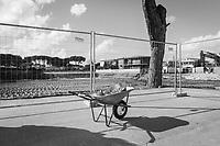 CASTELVOLTURNO (CE) - 3 FEBBRAIO 2018: Una carriola con cemento usata per la posa della prima pietra usata all'evento di apertura del cantiere per l'ampliamento della struttura ospedaliera dell'Ospedale Pineta Grande di Castelvolturno, inaugurato da Vincenzo De Luca (Partito Democratico), Presidente della Regione Campania ed ex sindaco di Salerno, a Castelvolturno (CE) il 3 febbraio 2018.<br /> <br /> Le elezioni politiche italiane del 2018 per il rinnovo dei due rami del Parlamento – il Senato della Repubblica e la Camera dei deputati – si terranno domenica 4 marzo 2018. Si voterà per l'elezione dei 630 deputati e dei 315 senatori elettivi della XVIII legislatura. Il voto sarà regolamentato dalla legge elettorale italiana del 2017, soprannominata Rosatellum bis, che troverà la sua prima applicazione<br /> <br /> ###<br /> <br /> CASTELVOLTURNO, ITALY - 3 FEBRUARY 2018: A hand-cart with cement used for the laying of the first stone at the inauguration event for the opening of the construction site for the extension of the Pineta Grande Hospital of Castelvolturno, inaugurated by Vincenzo De Luca (Democratic Party / Partito Democratico), President of the Campania region and former mayor of Salerno, is seen here in Castelvolturno, Italy, on February 3rd 2018.<br /> <br /> The 2018 Italian general election is due to be held on 4 March 2018 after the Italian Parliament was dissolved by President Sergio Mattarella on 28 December 2017.<br /> Voters will elect the 630 members of the Chamber of Deputies and the 315 elective members of the Senate of the Republic for the 18th legislature of the Republic of Italy, since 1948.
