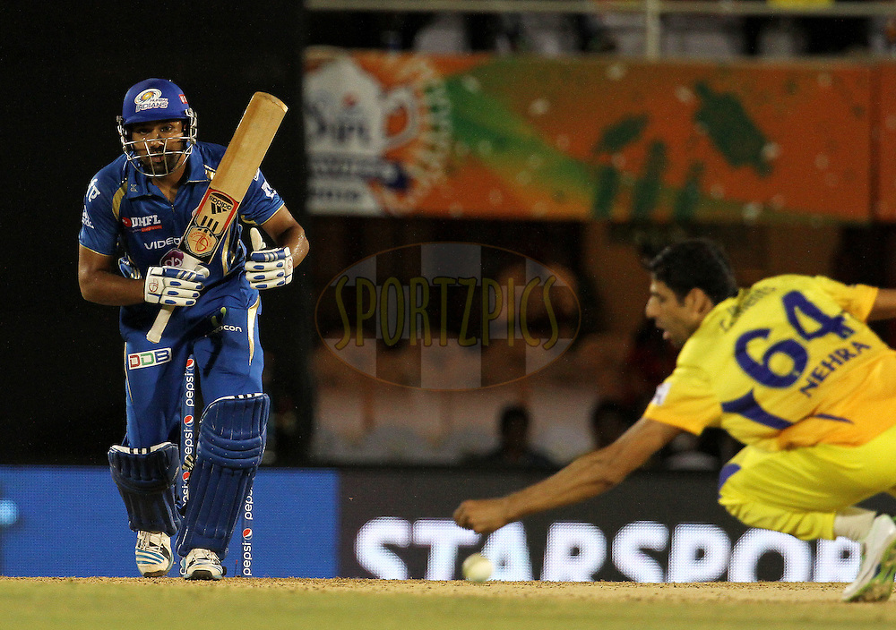 Rohit Sharma captain of the Mumbai Indians plays a shot during the eliminator match of the Pepsi Indian Premier League Season 2014 between the Chennai Superkings and the Mumbai Indians held at the Brabourne Stadium, Mumbai, India on the 28th May  2014<br /> <br /> Photo by Vipin Pawar / IPL / SPORTZPICS<br /> <br /> <br /> <br /> Image use subject to terms and conditions which can be found here:  http://sportzpics.photoshelter.com/gallery/Pepsi-IPL-Image-terms-and-conditions/G00004VW1IVJ.gB0/C0000TScjhBM6ikg