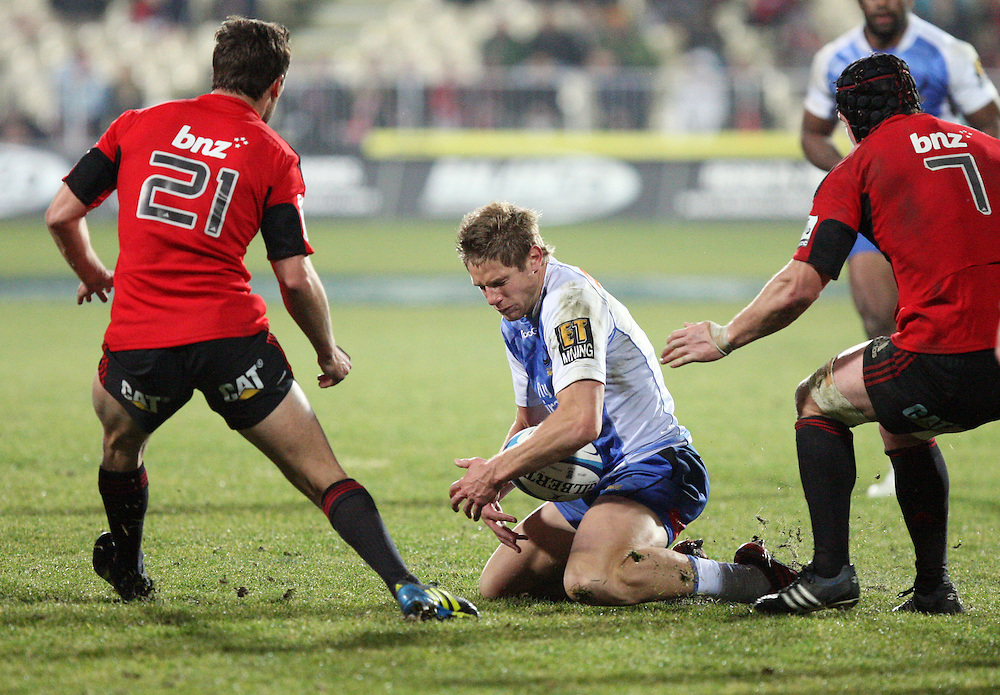 Forces Kyle Godwin, centre, looks to fend off the tackle of Crusaders Tom Taylor, left, and Matt Todd in the Super 15 rugby match at ANZ Stadium, Christchurch, Saturday, July 14, 2012. Credit:SNPA / Dianne Manson