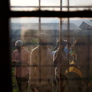 People queue for voting at a polling station in Kinama neighbourhood in Bujumbura, to vote in the country's parliamentary elections, on June 29, 2015.