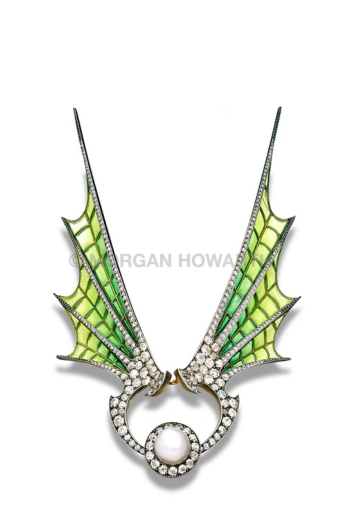 Plique-a-jour enamel spead over the wings with diamond borders centering a natural pearl surrounded by old cut diamond on gold by Maison Vever. Diamond tiara and convertable brooch with enameled bat wings and giant pearl