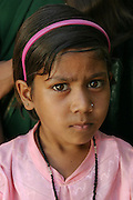 IND.MWdrv04.395.x..Portrait of Seema Yadav, who wasn't yet born when the Yadav family Material World portrait was taken in 1994. .Ahraura Village, Uttar Pradesh, India. Revisit with the family, 2004. The Yadavs were India's participants in Material World: A Global Family Portrait, 1994 (pages: 64-65), for which they took all of their possessions out of their house for a family-and-possessions-portrait. Child, Children..