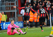 AFC Bournemouth midfielder Charlie Daniels celebrates with AFC Bournemouth forward Benik Afobe after scoring a penalty during the Barclays Premier League match between Bournemouth and Norwich City at the Goldsands Stadium, Bournemouth, England on 16 January 2016. Photo by Graham Hunt.
