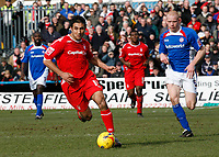 Jack Lester (left) attacks the Chesterfield defence, trailed by Derek Niven (right)