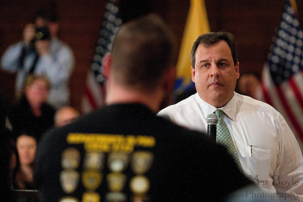 New Jersey Governor Chris Christie listens to a question from Michael Cramer of the PBA 122.