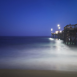 Newport Beach Balboa Pier at night photo. Newport Beach is a popular beach city in Orange County Southern California. Photo is 42 megapixels high resolution. Copyright ⓒ 2017 Paul Velgos with All Rights Reserved.