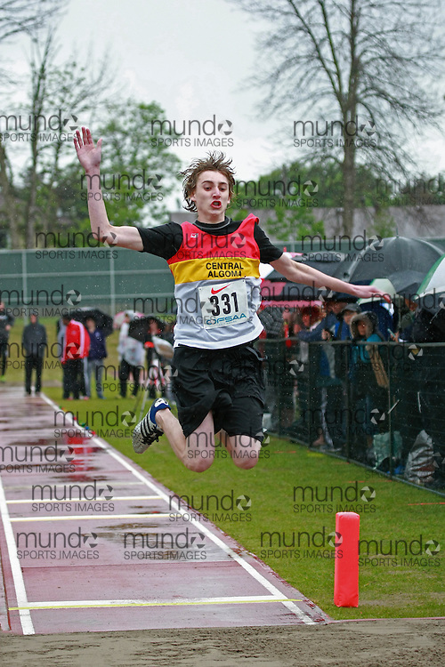 Merrick Adams of Central Algoma SS - Desbarats competes in the junior boys long jump at the 2013 OFSAA Track and Field Championship in Oshawa Ontario, Thursday,  June 6, 2013.<br /> Mundo Sport Images / Sean Burges