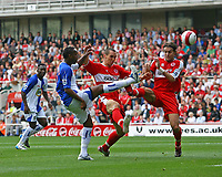 Photo: Andrew Unwin.<br />Middlesbrough v Blackburn Rovers. The Barclays Premiership. 23/09/2006.<br />Middlesbrough's Jonathan Woodgate (R) in action against Blackburn's Benni McCarthy (L).