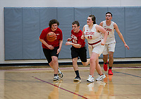 Austin Hanscom, Patrick O'Reilley and Elissa Pinard go after a loose ball during the LHS/BHS Unified Basketball game at Belmont High School on Monday afternoon.  (Karen Bobotas/for the Laconia Daily Sun)