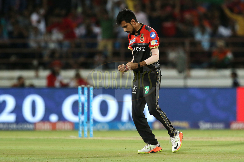 Yuzvendra Chahal of the Royal Challengers Bangalore celebrates the wicket of Gujarat Lions captain Suresh Raina during match 20 of the Vivo 2017 Indian Premier League between the Gujarat Lions and the Royal Challengers Bangalore  held at the Saurashtra Cricket Association Stadium in Rajkot, India on the 18th April 2017<br /> <br /> Photo by Vipin Pawar - Sportzpics - IPL